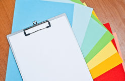 Folder and sheets of colored paper Stock Photography