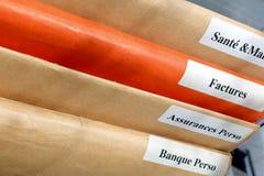 Folder stack on a desktop Stock Images