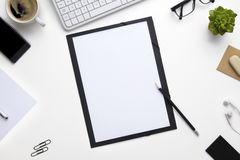 Folder Surrounded With Office Supplies Royalty Free Stock Images