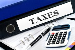Folder with taxes. Taxes folder with office tools royalty free stock photography