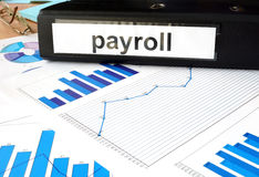 Folder with word payroll and graphs. Royalty Free Stock Image