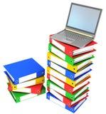 Folders. Colorful folders next to a modern laptop Stock Image