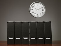 Folders and clock Royalty Free Stock Photography