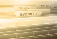 Folders. Closeup of Investments and Policies and Invoices tabs on folders Royalty Free Stock Photos