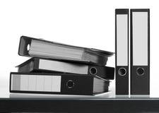 Folders on desk surface Stock Photography