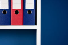 Folders for documents. In white bookcase Royalty Free Stock Photos