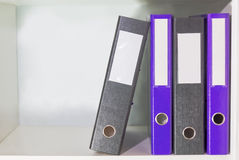 Folders for documents on a book shelf Royalty Free Stock Image