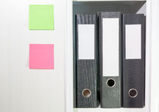 Folders for documents on a book shelf Royalty Free Stock Photo