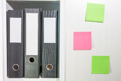 Folders for documents on a book shelf Stock Photo