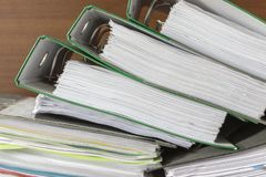 Folders of documents are stacked stock photo