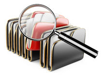 Folders and files search icon - folders under the magnifier. Stock Photo
