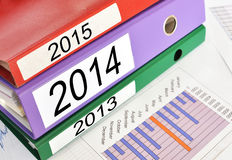 2013, 2014, 2015 folders. On a financial report Stock Images