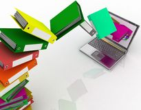 Folders fly into your laptop. Colorful folders fly into your laptop Stock Photos