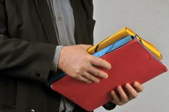 Folders in hand royalty free stock photo