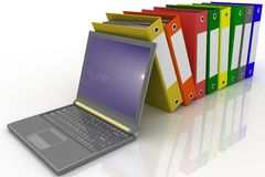 Folders and modern laptop. Colorful folders next to a modern laptop Stock Image