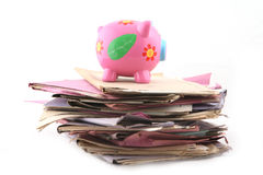 Folders with Piggybank. Isolated stack of folder with piggybank at the top shot over white background Royalty Free Stock Photos