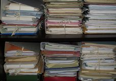 Folders. Shelf full of folders and files in an office Royalty Free Stock Images
