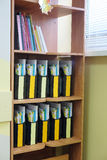 folders on a shelf Stock Images