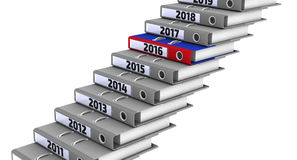 Folders stacked in the form of steps, marked the years 2011-2019. Focus for 2016. Gray office folders stacked in the form of steps, marked the years 2011-2019 Stock Image