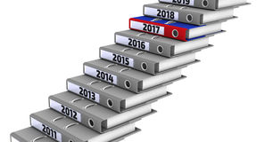 Folders stacked in the form of steps, marked the years 2011-2018. Focus for 2017 Royalty Free Stock Photos