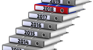 Folders stacked in the form of steps, marked the years 2014-2018. Focus for 2018. Gray office folders stacked in the form of steps, marked the years 2014-2018 Stock Photo