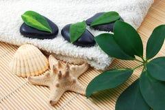 Foldet white bath towel and zen stones Royalty Free Stock Photography