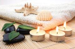 Foldet white bath towel and zen stones Royalty Free Stock Photo