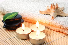 Foldet white bath towel and zen stones Royalty Free Stock Image