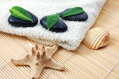 Foldet white bath towel and zen stones Royalty Free Stock Image