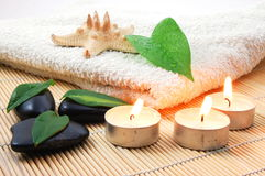 Foldet white bath towel and zen stones Royalty Free Stock Photo