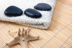 Foldet white bath towel and zen stones Stock Images