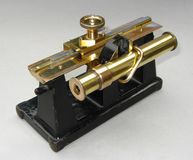 Folding antique microscope Royalty Free Stock Photos