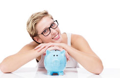 Folding arms over a piggy bank Royalty Free Stock Photo