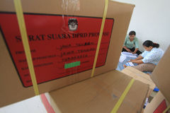 Folding Ballots For Election Representatives. Workers completed the process of folding the ballot paper in Solo, Central Java, Indonesia. The ballot papers used Royalty Free Stock Photo