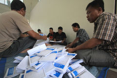 Folding Ballots For Election Representatives. Workers completed the process of folding the ballot paper in Solo, Central Java, Indonesia. The ballot papers used Royalty Free Stock Photos