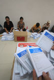 Folding Ballots For Election Representatives. Workers completed the process of folding the ballot paper in Solo, Central Java, Indonesia. The ballot papers used Stock Photo