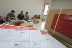Folding Ballots For Election Representatives. Workers completed the process of folding the ballot paper in Solo, Central Java, Indonesia. The ballot papers used Stock Photos