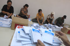 Folding Ballots For Election Representatives. Workers completed the process of folding the ballot paper in Solo, Central Java, Indonesia. The ballot papers used Royalty Free Stock Image