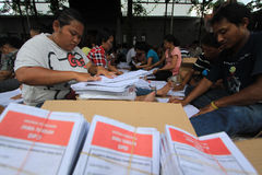 Folding Ballots For Election Representatives. Workers completed the process of folding the ballot paper in Solo, Central Java, Indonesia. The ballot papers used Stock Image