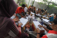 Folding Ballots For Election Representatives. Workers completed the process of folding the ballot paper in Solo, Central Java, Indonesia. The ballot papers used Royalty Free Stock Images