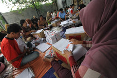 Folding Ballots For Election Representatives. Workers completed the process of folding the ballot paper in Solo, Central Java, Indonesia. The ballot papers used Stock Photography