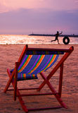 Folding Beach Chair at Dusk. Empty beach chair in the sand as the sun goes down Royalty Free Stock Photography