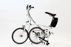 Folding bicycle 3. A pure white folding bicycle Stock Images