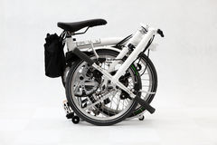Folding bicycle 4. A pure white folding bicycle Royalty Free Stock Image
