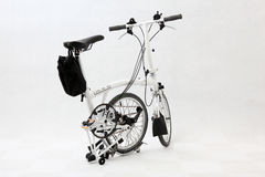 Folding bicycle 5. A pure white folding bicycle Stock Image