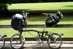 Folding bike with luggage Stock Photos