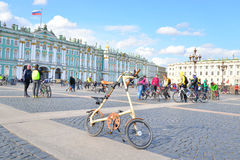 Folding bike Strida on Palace Square of St.Petersburg. Royalty Free Stock Images