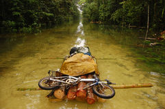Folding bycicle at raft flooded gravel road Stock Photo
