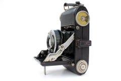 Folding camera. One of the old folding camera on wgite background Royalty Free Stock Image