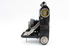 Folding camera. Old folding camera on wgite background Stock Image